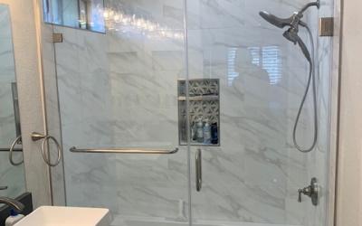 walk-in shower in gray tone