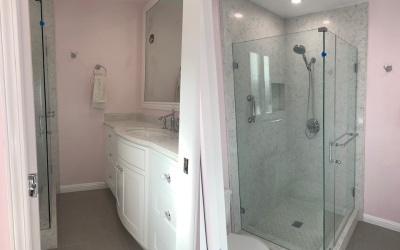 shower with pink walls and vanity